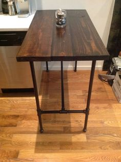 Reclaimed Wood Kitchen Table with Black Pipe Legs by ReformedWood