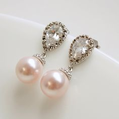 Wedding Jewelry Cubic Zirconia Pearl Bridal Earrings Bridesmaid Earrings Posts Silver with Blush Rose Swarovski Pearl Drops Pearl Jewelry. $32.00, via Etsy.