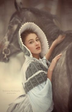 BLACK ROSE MANOR - Emily prepared to mount the horse and ride to be at her lovers side.
