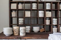 miss mustard seed   antique mail sorter   miss mustard seed shared more of her favorite finds for the Lucketts Spring Market. See how she styles an antique mail sorter with antique marmalade jars and vintage ironstone.