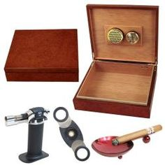 @Overstock.com - Cigar Humidor and Accessories Set Tres - Keep your expensive cigars fresh with this wooden cigar humidor. Capable of holding 25 cigars, it features gold-plated hinges and a felt-lined bottom for added elegance. A cigar cutter, table lighter, and ashtray are included for your convenience.  http://www.overstock.com/Gifts-Flowers/Cigar-Humidor-and-Accessories-Set-Tres/6367080/product.html?CID=214117 $49.99