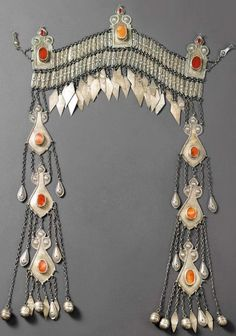 Turkestan | Frontal head ornament ~ sinsileh ~ from the Ersari people.  Silver, silver gilt and carnelians |  ca. 20th century