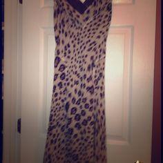 Alfani silk animal print dress size 2 REDUCED Beautiful slimming Alfani silk cocktail dinner dress barely worn. Below knee  size 2. Cuts in at waist. V-neck front and back. Flowing bottom skirt.  Love this dress. Too big Alfani Dresses