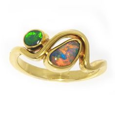 Our gorgeous #lostseaopals rhythm ring - black opal yellow gold heaven! #opalsaustralia