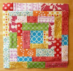 I think this is done with scraps sewn in a strip then sewn as a log cabin