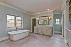 """Transform Your Bathroom Into a Luxurious Spa — Choose The Right Color (Fox News Magazine; photo credit: ABHomeInteriors.com) (""""'Paint your bathroom a cool, refreshing color like light grey, blue or white,' says Amanda Gates, who specializes in residential interior design. 'It creates a calming effect and reduces stress. A terrific example is Benjamin Moore's Woodlawn Blue HC-147.'"""")"""