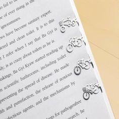 Puntos de libro originales de inspiración vintage. Diseño bicicletas retro en acero inoxidable.