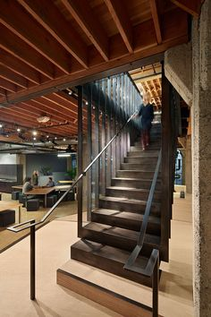Heavybit Industries, a new curated community for cloud software developers, is designed as a series of architectural interventions inserted into an existing . Warehouse Office, Warehouse Design, Commercial Interior Design, Commercial Interiors, Prison, Tole Pliée, Habitat Collectif, Steel Barns, Stair Detail