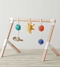 Shop Wooden Baby Gym. The clean and simple design of this wooden baby gym means it can easily fit in anywhere in your home, from a nursery to a living room. Add any of our hanging plush rattle sets and give your little one hours of nonstop entertainment.