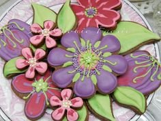 Passion Flowers ~ Chocolate Cut-out Cookies with Royal Icing for Wedding Shower Centrepiece. Colour palette was inspired by bridesmaids' dresses and the party table decor. {The Cookie Faerie}  http://pinterest.com/thecookiefaerie/cookie-gallery-by-robin-traversy/