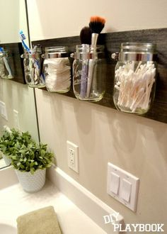 Mason Jar Organizer = flower vases in the sunroom
