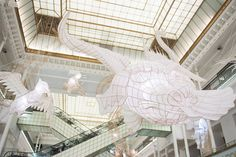 Bamboo & Paper Creatures Sculptures by Ai WeiWei in Paris  For the Parisian department store Le Bon Marché Rive Gauche Ai WeiWei comes with an installation as amazing as his previous ones : suspended creatures sculptures made from bamboo (for its flexibility) and paper (for its weightlessness). The artist transformed this commercial gallery into a historical center with aerial and shops artworks called Er Xi (Childs Play). These mythological creatures come from popular legends of the Antique…
