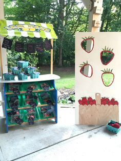 Strawberry Farmers Market party was a hit! Favors on the lemonade stand and bean bag game with crocheted strawberry bean bags