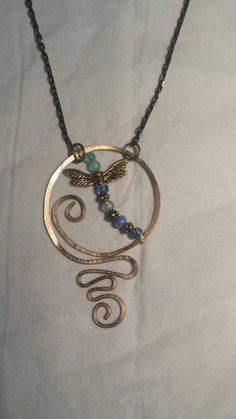 Hand worked, wired wrapped, #hammered #dragonfly #pendant in #antique brass with 2mm, round glass beads.  Pendant will arrive beautifully packaged to gift or add to your own co... #trending #jewelry #necklaces #vintage #handmade #statement #necklace #different #funky #spring #boho