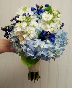 Blue and white bridal bouquet with hydrangea, stock, and delphinium