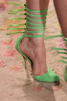 Antonio Berardi Fall 2011. Zip-ties for the ankles, an unfortunate green color sure to clash with everything, and -- worst of all -- a horrendously uncomfortable design. Just look at where her foot goes into the toe box. *wince*