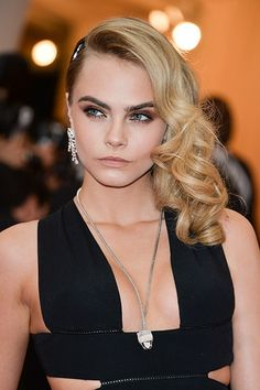 She scores another beauty hit with her Met Gala appearance. That eye makeup alone deserves a mention, with its crisp liner, smoky depth and diffused, angled edges. Then there's the cheekbone-emphasizing peachy blush, lit-from-within skin, and lustrous, bouncy curls.