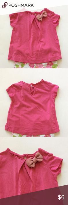 Zara Baby Girl T shirt Zara Baby Girl T shirt. Bright pink color. Little bow on the left shoulder. Keyhole closure in back. Cotton. Size 3-6 mths. Good condition. Pairs perfectly with the Janie and Jack floral shorts. Zara Kids Shirts & Tops Tees - Short Sleeve