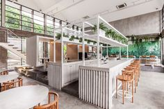 X+O Bring Brutalist Interior Architecture To A Café In Ubud Ubud, Tiled Staircase, Interior Architecture, Interior Design, Monochrome Interior, Interior Paint, Timber Table, Counter Design, Terrazzo Flooring