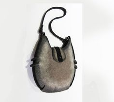 felt bag, bag, crossbody bag, shoulder bag  Handmade bag from sheep`s wool. Two pockets inside, one fastens with zipper. Handle will not swap because
