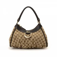 894050ab0d0 LXRandCo guarantees this is an authentic vintage Gucci D Gold Hobo Bag  shoulder bag.