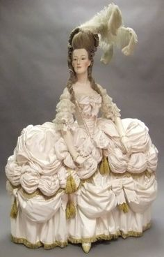 A unique life size mannequin of Marie Antoinette, half body on stand, with glass eyes and elaborate 18th century style powdered wig with ostrich plumes and wearing and 18th century style Court costume. NOTE: This mannequin was commissioned by Count Alexander von Beregsahsy and modelled from portraits of Marie Antoinette. It was used for display at his shop in the Mall, Camden Passage. by melody