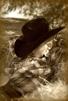 Lil' cowboy, all tuckered out! www.duderanchroundup.com