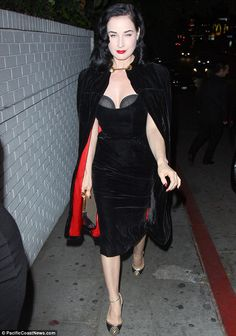 The lady is a vamp: Dita Von Teese wears a striking black ensemble as she leaves the Chateau Marmont in West Hollywood on Wednesday