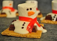 S'Mores Melting Snowman:    Take a graham cracker and place Hershey Bar in the middle.  Pour melted white chocolate over Hershey Bar.  While the chocolate is still warm add a marshmallow on top of the white chocolate in the center.  Wrap a piece of the fruit roll  around marshmallow for scarf.  Add the eyes and nose with a tube of decorative icing with a fine point.