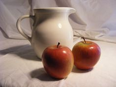 Pitcher and 2 apples