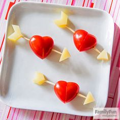 Let your kids make these simple tomato and cheese skewers and they just might fall in love with healthy snacking. Start by diagonally trimming away the ends of two grape tomatoes and trimming small pieces of cheese (we used cheddar) for the arrow parts. Then have your kids assemble the pieces on a toothpick as shown.                 Originally published in the February 2015 issue of FamilyFun magazine.