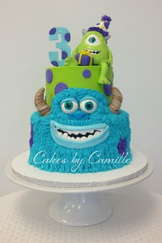 Disney Themed Cakes - Monsters Inc, University Cake, Sulley is piped buttercream with fondant accents, Mike is sculpted from fondant, Top tier smooth buttercream.