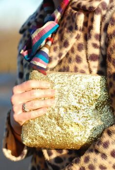 This woman goes on about her love for Jimmy Choo and Kate Spade, then tells you how to coat a thrift store purse in a thick layer of Mod Podge and children's craft glitter.  HAAAAAAAAAAAAAA