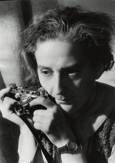 Lotte Jacobi(1896-1990) - German photographer, who immigrated to the United States to escape Nazi Germany. Self Portrait with Leica,1937