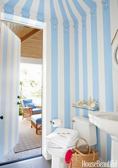 In a Palm Beach house decorated by Mimi McMakin and Ashley Sharpe of Kemble Interiors, a powder room near the pool is painted to look like a cabana with a tasseled, tented awning. Even the door has the striped pattern. Bathroom Color Schemes, Bathroom Paint Colors, Pool House Bathroom, Powder Room Decor, Powder Rooms, Beach Design, Striped Wallpaper, Blue Rooms, West Palm Beach
