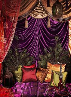Melissa's note: this is too garish/circusy (the bright silky purple + other silks are way too much for my bedroom- too carnivalesque-- I want a sanctuary :-) ) but I love and have loads of peacock feathers, and I have lots of curtains and lanterns just like these.
