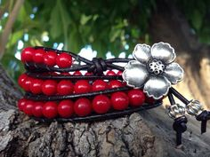 Beaded Wrap Bracelet Photo.. Inspiration, red beads, silver flower clasp.  Must make list.