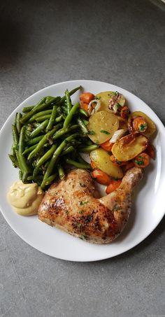 Cuisses de poulet et légumes au four