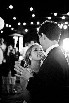 happy dancing bride and groom in wedding reception