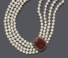 PEARL NECKLACE WITH ANTIQUE GARNET AND DIAMOND CLASP, ca. 1840. Silver and pink gold. Composed of 4 strands of graduated Akoya cultured pearls of ca. 6,5 -6,8 mm, the clasp set with a garnet of ca. 23 x 19 mm, surrounded by circular-cut diamonds, weighing ca. 0.50 ct. L ca. 37,5 cm.