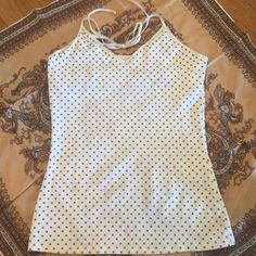 Express polka dot halter tank Super cute halter tank with hidden shelf bra and sparkly gold polka dots and gold trim. Fits tightly. In great condition. Express Tops Tank Tops