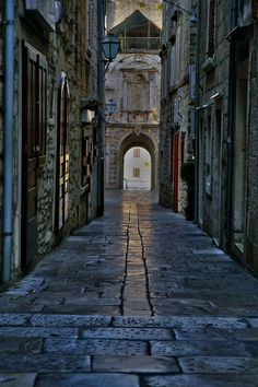 Streets of Korcula, Croatia. Korčula is an island in the Adriatic Sea, in the Dubrovnik-Neretva County of Croatia. The island lies just off the Dalmatian coast.