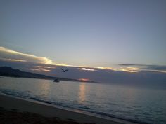 WHEN THE SUN RISES AT MEDANO BEACH CABOS SAN LUCAS