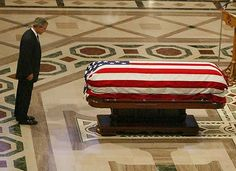 """""""One of the very few occasions when a head-of-state should stand with their feet together: George W. Bush is seen paying his respects at the funeral of former U.S. President, Ronald Reagan. Standing with your feet touching or very close together as President Bush is here, in the vast majority of scenarios is a signal of low confidence and/or low psychological comfort. The other meaning of this nonverbal is the emotion of, and/or desire to demonstrate respect, as he is here in this stance."""""""