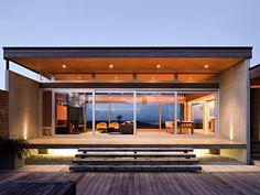 Beach House by CCCA | As if this home wasn't pretty enough, the floor-to-ceiling windows offer sweeping views of the surrounding New Zealand landscape.