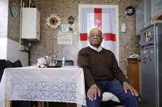Retired department store employee Alvan Melbourne, 83, poses in his kitchen in London September 12, 2014. REUTERS/Suzanne Plunkett