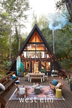 Create colorful, casual vibes wherever you live. Check out this updated slant on the A-frame revival. A Frame Cabin, A Frame House, Cabana, Wood Patio Chairs, Outdoor Patio Designs, Outdoor Spaces, Cabin In The Woods, Farmhouse Style Kitchen, Farmhouse Chic