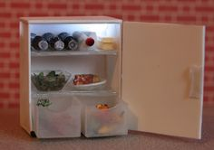 A mini scale working fridge! My riders would like one in the lounge. The shelves are pill boxes!!