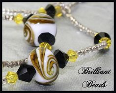 Black & Yellow Swirled Handmade Lampwork Bracelet by Gillianbeads
