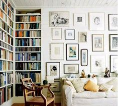 pencil drawing gallery, book shelves, white room, neutral colour scheme